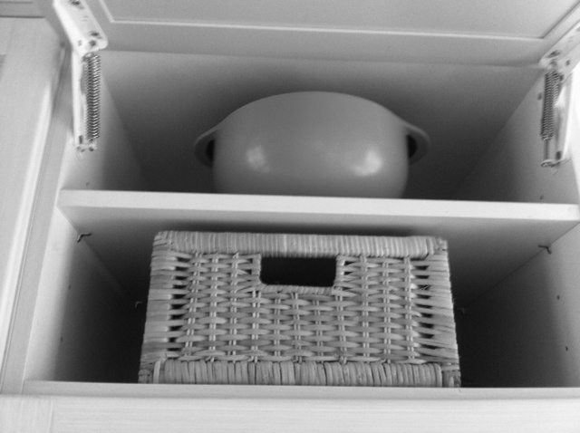 basket in kitchen cupboard