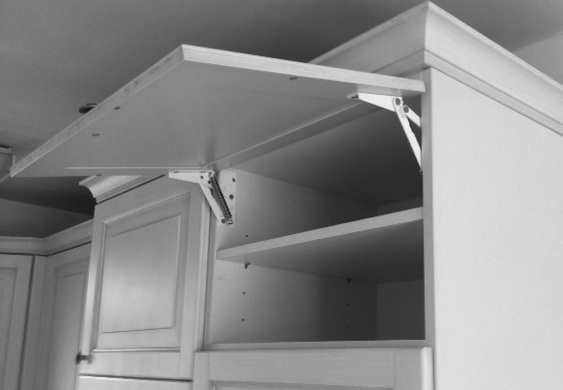 Kitchen door cupboard opens upwards